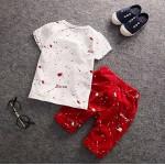 Σετ κοντό παντελονάκι - μπλούζα κοντομάνικη με σχέδιο και στάμπα αστέρι και πιτσιλιές, λευκό - κόκκινο